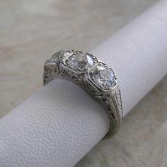 Art Deco Antique Original Platinum Three Stone Diamond Engagement Ring. $3,800.00, via Etsy.