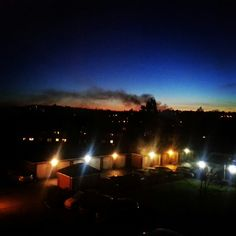 Redhill at dusk with bonfire smoke
