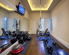 work out equipment, upstairs, long narrow along back wall, not over master area.
