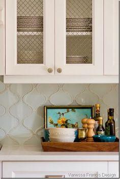 glass backsplash & cabinet with chicken wire Love this backsplash!