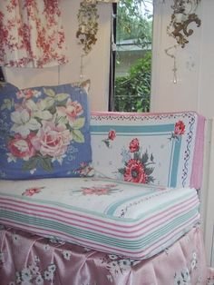 Camper cushions covered with a vintage tablecloth and pink vintage chenille.  Pillows are covered with 1940s soft cottons. | http://pinkcottage.blogspot.com/2007/01/my-cottage-camper.html#