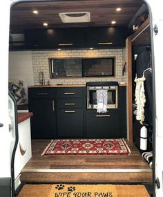 This Converted Sprinter Van is a Surprisingly Livable Tiny House on Wheels - Van living Sprinter Van Conversion, Camper Conversion, Van Conversion Bathroom, Van Conversion Transit, Van Kitchen, Kitchen Decor, Kitchen Ideas, Kitchen Black, Black Kitchens