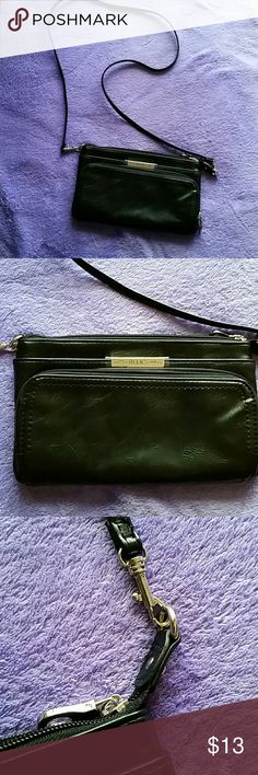 Relic cross body black purse Measures 9x5.  Never used. Has cute strap clips you can remove.  Has credit card slots in fron pouch.  Has non zip pocket between front and zip.pocket. Relic Bags Crossbody Bags