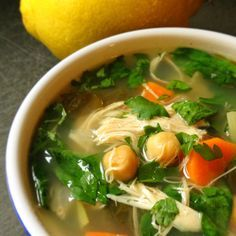 LEMONY CHICKEN SOUP W/ GREENS  1 large onion – diced  2 c carrot – diced  3 c celery – diced  4 cloves garlic – finely chopped  1 tsp kosher salt  ½ tsp pepper  ½ tbs cinnamon  6 c chicken broth – low sodium  10 large sprigs parsley plus extra for garnish  1 lb chicken breasts  1 bag spinach  15 oz can chick peas – washed and drained  Juice of ½ a lemon (or more to taste)
