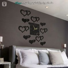 e1a68d790 ساعة حائط خشبيه قلوب لون الخشب أسود