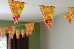 brilliant garland = paper napkins cut into triangles and laid over ribbon/string. tape or staple closed.