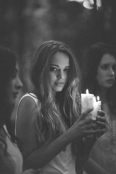 I feel this image can have different perspectives to it. My perspective on the photo is that maybe there at their friends candle lit night and are waiting for her to return back home to her love ones. portrait Photography