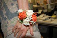 Orange and cream wrist corsage