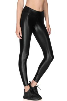 Made from their Infinity fabric, Koral's signature liquid-like legging is an absolute essential. Whether you wear them in or out of the water, with sneakers or with heels, they'll keep you on top of your game. H20-Friendly. If you're wondering the fit of these beauties, you can expect a mid rise, figure forming legging. Cropped just above the ankle. Recommended for medium performance.   Lustrous Legging by KORAL. Clothing - Activewear Rhode Island