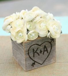 Engraved rustic box filled with lovely white roses perfect for a bridal shower centerpiece.  See more bridal shower decorations and party ideas at www.one-stop-party-ideas.com