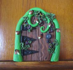 Fairy Door with glow in the dark fireflies by DawnsClayFantasy