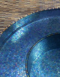 Oceanside Glasstile Spa with Tourmaline irdescent in Tessera Collection, and Coppertone Blend accent in Muse Collection pattern: Prose