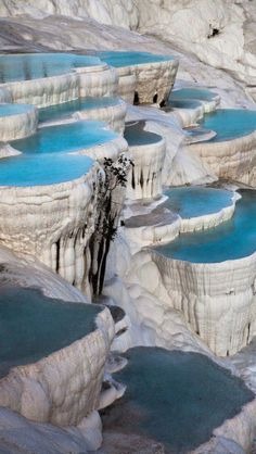 Natural Rock Pools, Pamukkale Turkey. Pamukkale's terraces are made of travertine, a carbonate sedimentary rock deposited by water from the hot springs.