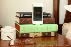 <p>Clear the cord clutter by hiding your phone charger in a stack of colorful books (you already kno... - Little Lovelies