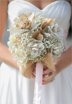 Beautiful handmade wedding for under 10K. #weddingchicks Captured By: KMI Photography Inc. http://www.weddingchicks.com/2014/06/30/we-love-books-wedding-under-10k/