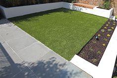 slate grey + white rendered walls + fake grass