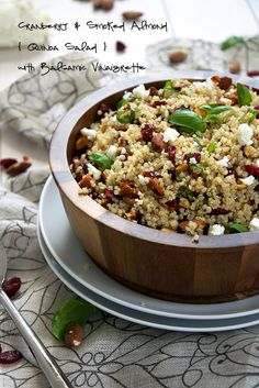 A simple, make ahead quinoa salad filled with tart cranberries, smoked almonds, basil, creamy goat cheese and finished with a homemade balsamic dressing! from The Housewife in Training Files Healthy Salad Recipes, Vegetarian Recipes, Cooking Recipes, Vegan Meals, Cooking Ideas, Couscous, Homemade Balsamic Dressing, Cranberry Almond, Cranberry Recipes
