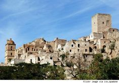 Craco  Location: Craco, Basilicata, Italy  Story: Built on a summit, Craco's utility was initially derived from its ability to repel invaders. The town's placement on a cliff precipice also threatened its integrity. After being rocked by a number of earthquakes and subsequent landslides, Craco was abandoned for lower ground. Today, the empty village is great for exploration and houses a number of interesting old world churches such as Santa Maria della Stella.  Abandoned since: 1963