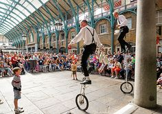Picture of unicyclists performing in Covent Garden, London, England