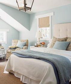 blue walls anchor a calming neutral (taupe/flax) scheme... simply serene with cool blues