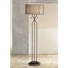 A floor lamp design with strong vertical lines, a handsome bronze finish, and a textural burlap fabric drum shade.