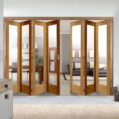 Freefold Oak Pattern 10 Style Folding 7 Door Set with Clear Glass, Height 2090mm, Width 4338mm. #glazeddoors #foldingdoors #freefolddoors