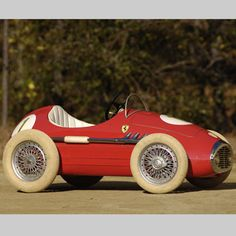 *PEDAL CAR ~ 1950'S Ferrari.    The rich kid up the block had one of these...I hated the rich kid up the block.