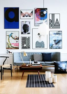 Danish modern sofa with Ikea rug and gallery wall.