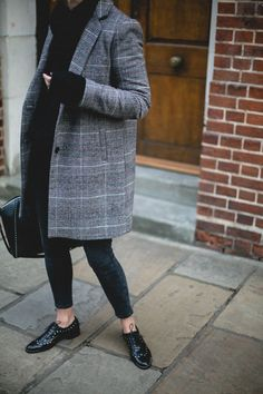Emma Hill wears Givenchy medium Antigona bag with studs, studded patent brogues, black skinny jeans, check coat, chunky black knitted sweater with high neck, winter outfit ideas