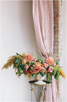 Asymmetric arrangement with dahlias and amaranths