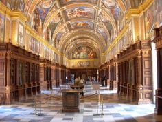 """They visited El Escorial library and admired """"vellum pages with their margins ornamented with paintings."""""""