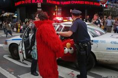 Everyone has a bad day... A man, dressed as the Muppet character Elmo, is arrested in New York's Times Square.
