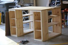 """DIY craft table (I'd probably fill in that center area with long shelves for storing 32 x 40"""" mat board and similar)"""