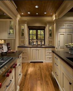 Amazing kitchen! Love the wood ceiling..