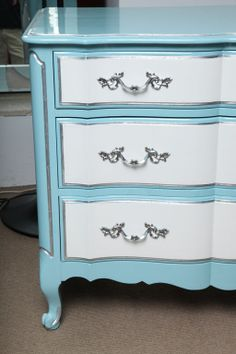 french provincial chest of drawers lacquered baby blue and white with silver leaves accents. Chrome handles