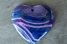 Gorgeous, designer stone pendant is genuine onyx agate stone.  Pretty stone pendant is a puffed heart shape. Color is shades of blue, pink, and white, and the stone is dyed.  Just gorgeous!!  Pendant is drilled at the top from front to back.  Stone measures 43x40x6mm. Stone pendant is one of a kind.  Try using a pinch bail to connect pendant to a chain, or your design.    ~~~Please see announcement on shop home page for current information on deals, offers, and shipping.~~~     Please check…