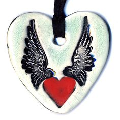 Heart with Wings Ceramic Necklace in Crackle by surly on Etsy, $18.00