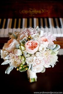 Juliet garden roses, blushing bride protea, cafe au lait dahlias, dusty miller, peach hypericum berries and cream spray roses.