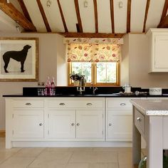 Country kitchen with black granite worktop