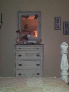 Distressed white dresser, mirror and bed post.  Www.lonesomedovemercantile.com