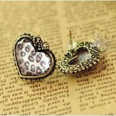 $3.89Pink Heart Shaped Leopard Stud Earrings  Get 10% OFF your orde      Coupon code: belleu01