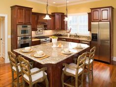 Eat-in kitchen design with dining island