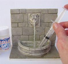 Faire de l'eau en mouvement (bouteille, évier...). Le produit de trouve en France (magasins de maquettisme. J'en ai aussi vu ici: http://www.oupsmodel.com/neige-sable-graviers-c-20_460_573.html)