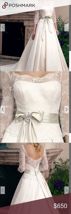 Like new Casablanca Bridal wedding gown ivory - 8! Like new Casablanca Bridal Style 1800 wedding gown! Retail $1399.00. Purchased August 2016, worn indoors 3 hours in September then dry cleaned. Street size 8-10, never altered, comes with bustle sewn in. Brooch from stock photo NOT included. beaded romantic lace, sweetheart bodice, 3/4 length sleeves. Box pleats in skirt, chapel train,  satin tie and bow at waist. Satin buttons. Silky Satin, Beaded Lace in ivory and champagne. Comes from…