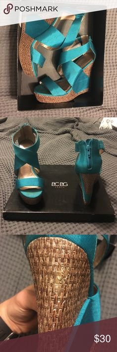 BCBG Peacock rando wedges size 8 1/2 Beautiful teal/blue color. Have a small tear in the wicker material on the back of the right shoe ( pictured). Light wear worn a few times. Insanely comfortable for being a 4 1/2-5inch high heel. BCBG Shoes Wedges