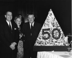 Description: Description: Left to right: Van Zandt Williams, Mary Warga, and Harold Thompson at the 50th Anniversary meeting of the Optical Society of America (OSA), at the Museum of History and Technology. Credit line: The Smithsonian Institution, courtesy AIP Emilio Segre Visual Archives Photo date: March 15, 1966