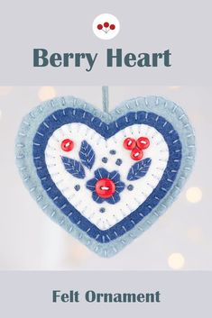 This Nordic folk art inspired Berry ornament is hand stitched in layers of felt with appliqued and embroidered leaves, and decorated with tiny buttons.It measures 3.5 inches / 9cm wide, has a plain felt back and a cotton loop for hanging.The Berry heart is part of a collection including the matching star and the Mistletoe heart shown in the final photos. They are available individually or as a set. #nordicchristmas #scandichristmas feltchristmasornaments #berryornament Scandi Christmas, Embroidered Leaves, Felt Christmas Ornaments, Star Ornament, Felt Hearts, Handmade Felt, Mistletoe, Hand Stitching, Folk Art