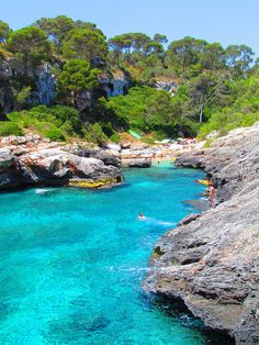 Go for a swim in crystal clear water of Cala s'Almunia. Found in Mallorca, Spain, this beach is framed by rocks that create a staircase into the bay.