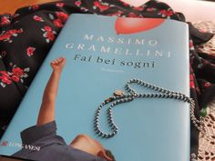 """i love this book 'cause tell a true story about a man who succeed to overcome the truth with enormous courage to live in peace with himself, the people and his monsters. (this photo was taken by me.)   """"fai bei sogni, anzi fateli assieme. assieme valgono di più."""" -cit."""