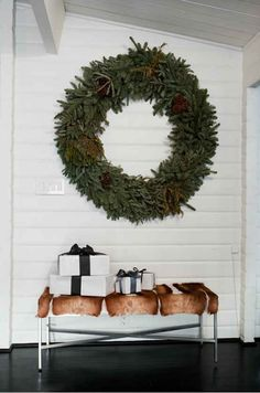 What isn't to love about this oversize wreath, simple black and white wrapping and that gorgeous bench?!